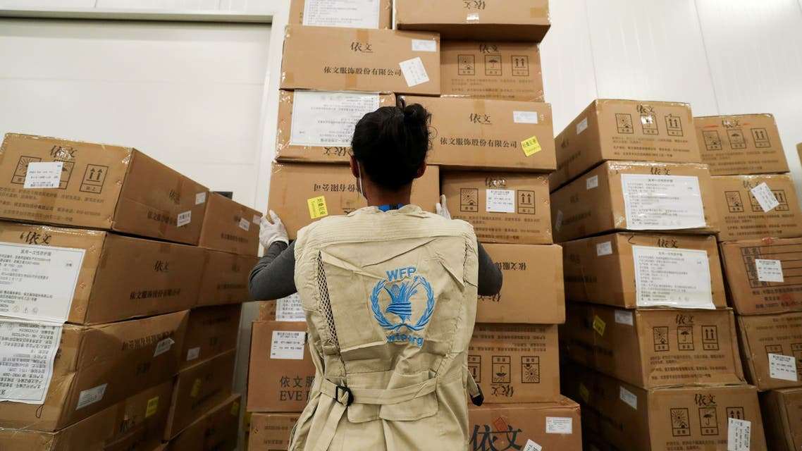 A World Food Program (WFP) worker arranges relief packages at a warehouse designated to the United Nations for humanitarian aid for Africa to combat the outbreak of the coronavirus disease (COVID-19), at the Bole International Airport in Addis Ababa, Ethiopia April 14, 2020. REUTERS/Tiksa Negeri