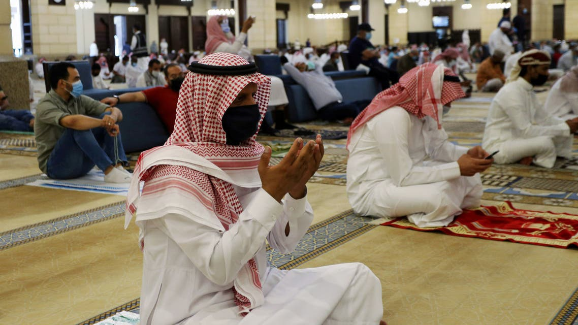 A Saudi man wearing a protective face mask performs the Friday prayers inside the Al-Rajhi Mosque, after the announcement of the easing of lockdown measures amid the coronavirus disease (COVID-19) outbreak, in Riyadh. (Reuters)