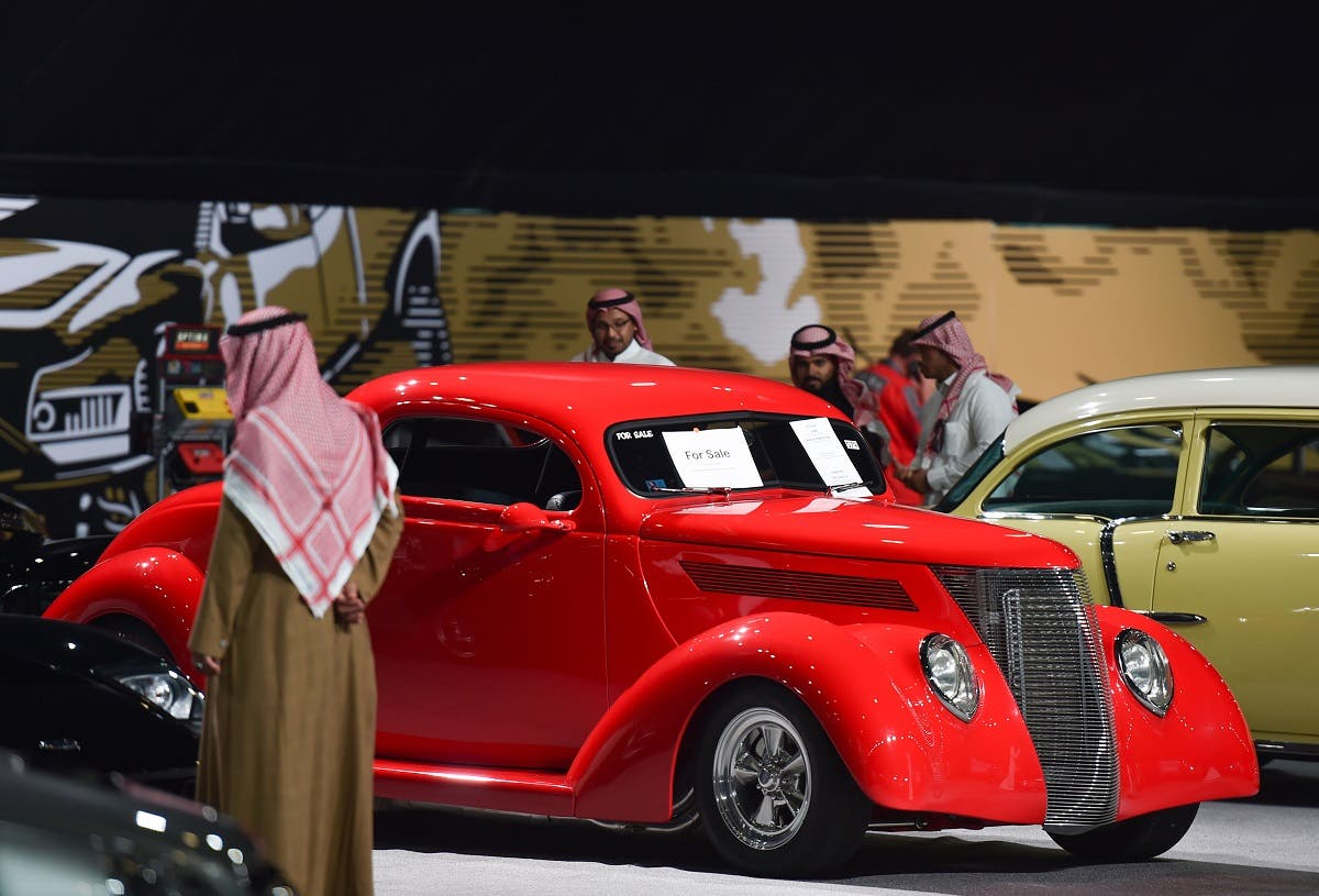 Visitors view classic cars displayed for sale in a special exhibition, during the Riyadh Motor Show at Al-Janadriyah village in the Saudi capital, on November 24, 2019. (AFP)