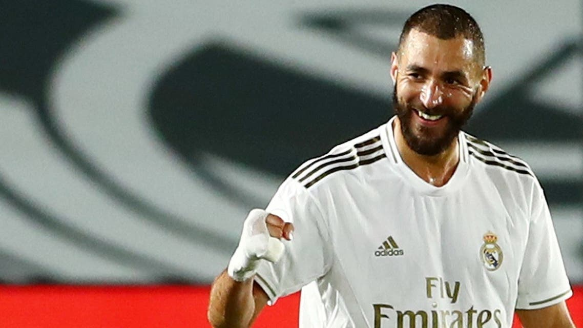 Real Madrid's Karim Benzema celebrates scoring their third goal as play resumes behind closed doors following the outbreak of the coronavirus disease (COVID-19). (Reuters)