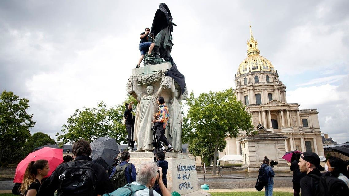 Anticolonial activists cover French military commander Joseph Gallieni statue with a black cloth, in Paris, Thursday, June 18, 2020. (AP)
