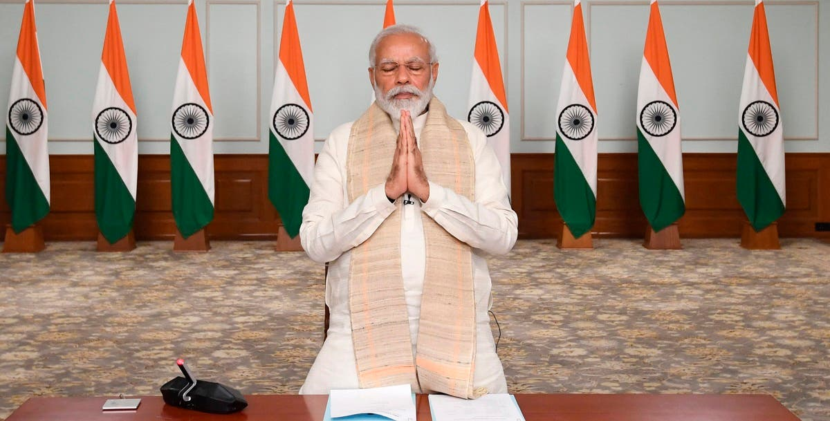 Prime Minister Narendra Modi pays tributes to Indian soldiers killed during confrontation with Chinese soldiers in the Ladakh region as he holds a video conference with chief ministers, in New Delhi, India, on June 17, 2020. (AP)