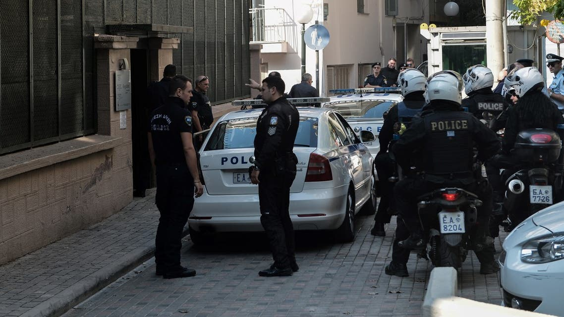 Police officers stand guard outside of the Turkish Consulate after a demonstration against the Turkey's military operation in northeastern Syria by anarchist group of Rouviconas, in Thessaloniki on October 17, 2019.
