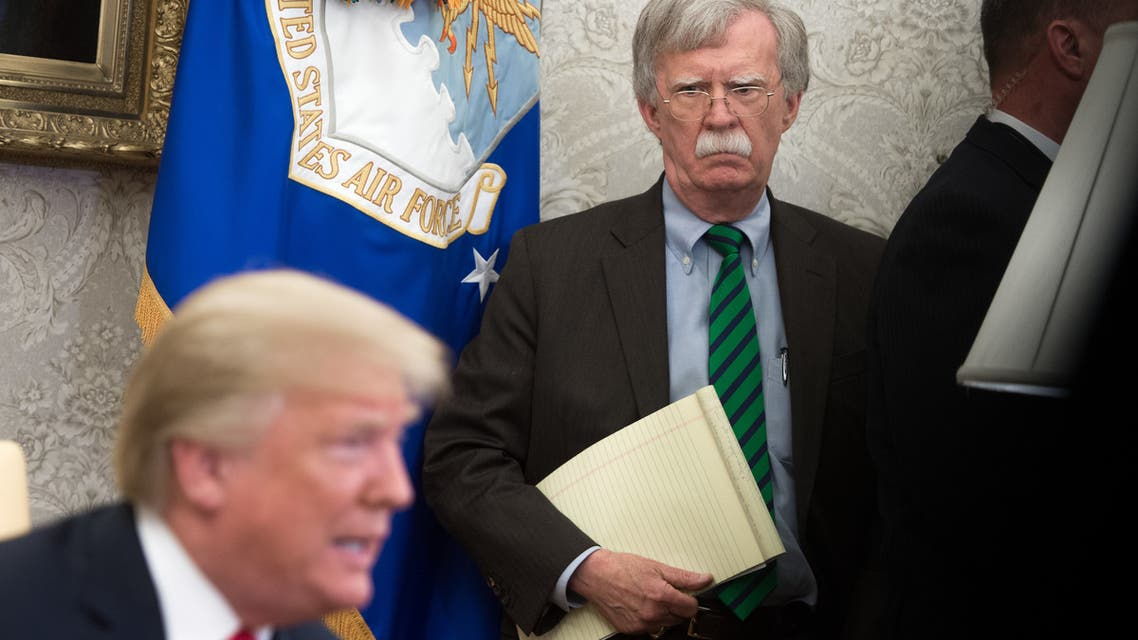 (FILES) In this file photo taken on May 13, 2019, National Security Advisor John Bolton listens while US President Donald Trump speaks to the press before a meeting with Hungary's Prime Minister Viktor Orban in the Oval Office of the White House in Washington, DC. Trump has no guiding principles and is unfit to be president, Bolton said in an interview released on June 18, 2020, to promote his explosive book. I don't think he's fit for office. I don't think he has the competence to carry out the job, Bolton told ABC News.