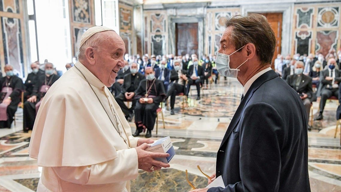 Pope Francis (L) talking with President of the Lombardy region, Attilio Fontana during a private audience in The Vatican with the region's doctors, nurses and health care workers. (AFP)