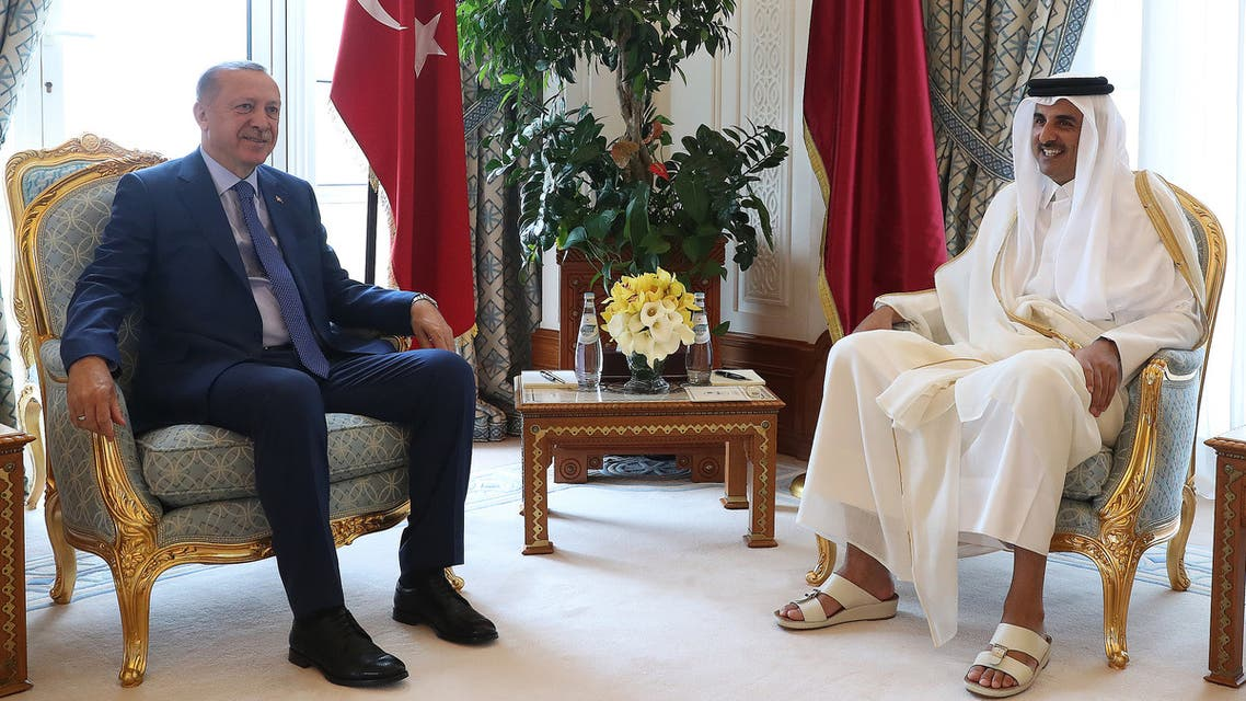 A handout picture provided by the Turkish Presidential Press Service shows Qatar's Emir Sheikh Tamim bin Hamad al-Thani (R), meeting with Turkish President Recep Tayyip Erdogan in the Qatari capital Doha on November 25, 2019. Erdogan arrived in Qatar today on his first official trip to an Arab country since Ankara's forces intervened in northeast Syria last month against Kurdish fighters.