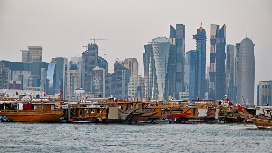 A general view taken on December 20, 2019 shows boats moored in front of the skyline of the Qatari capital, Doha. (AFP)