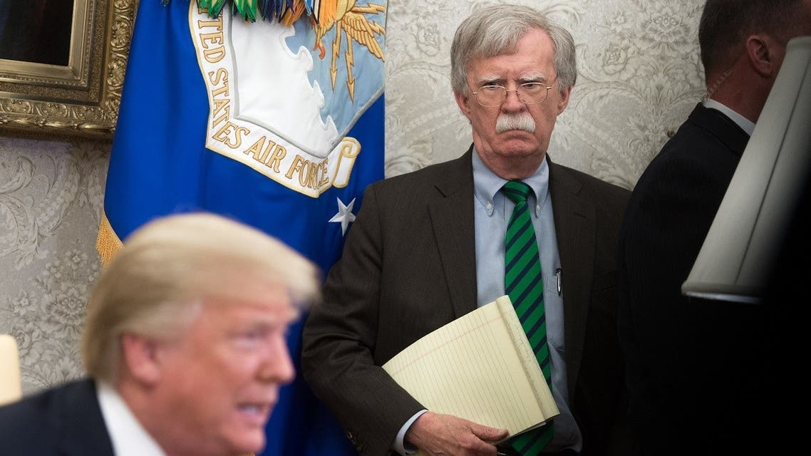 In this file photo National Security Adviser John Bolton stands alongside US President Donald Trump as he speaks during a meeting with NATO Secretary General Jens Stoltenberg in the Oval Office of the White House in Washington, DC, May 17, 2018. (AFP)