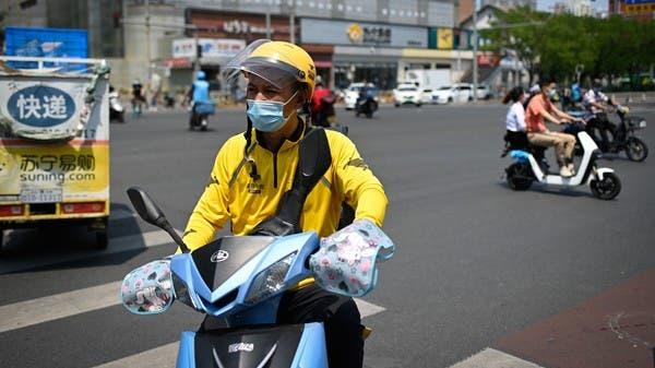 بكين تُخضع عمال توصيل الطعام والطرود لاختبارات كورونا
