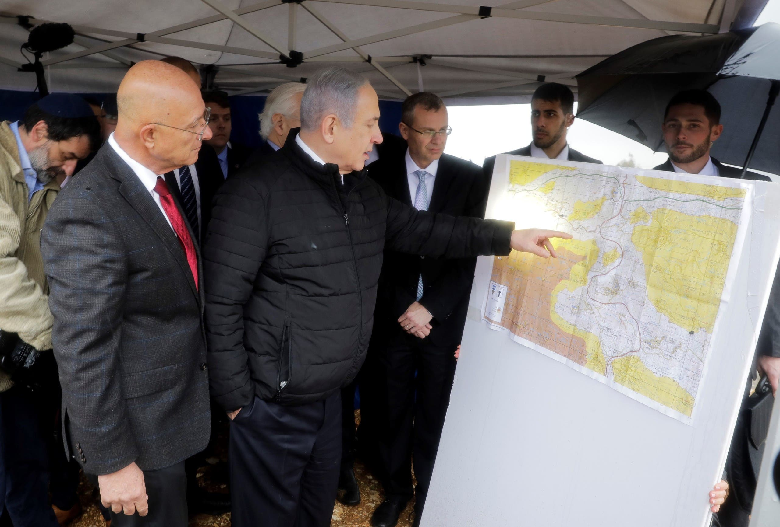 In this Feb. 24, 2020, file photo, Israeli Prime Minister Benjamin Netanyahu checks the area map during visit to Ariel settlement in the West Bank. (AP)