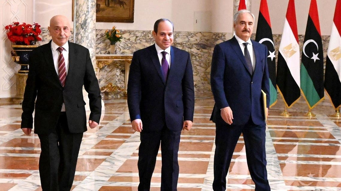 A handout picture released by the Egyptian Presidency on June 6, 2020 shows Egyptian President Abdel Fattah al-Sisi (C), Libyan commander Khalifa Haftar (R) and the Libyan Parliament speaker Aguila Saleh arriving for a joint press conference in the capital Cairo.  (AFP)