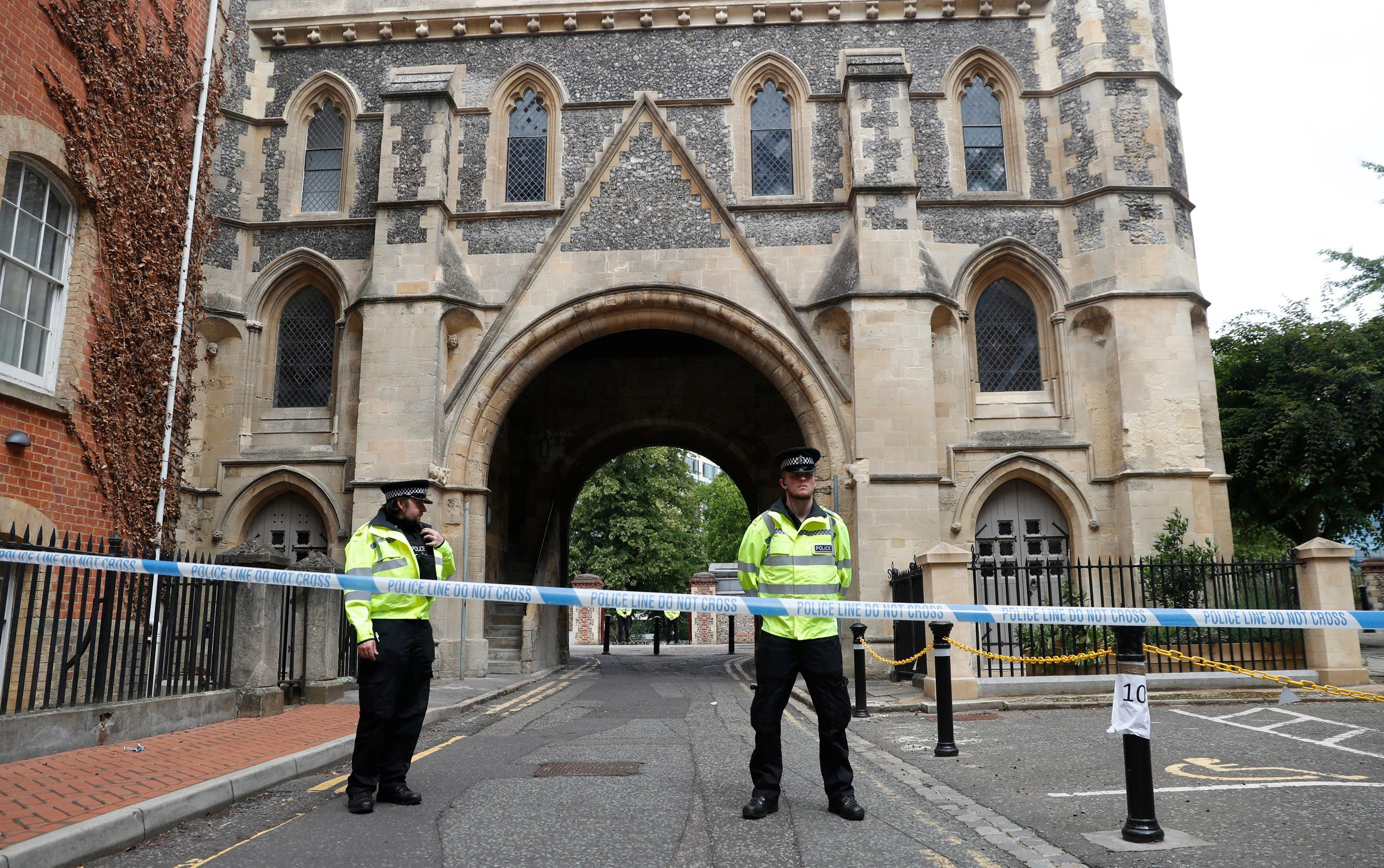 Police stand guard at the Abbey gateway of Forbury Gardens, a day after a multiple stabbing attack in the gardens in Reading, England on June 21, 2020. (AP)