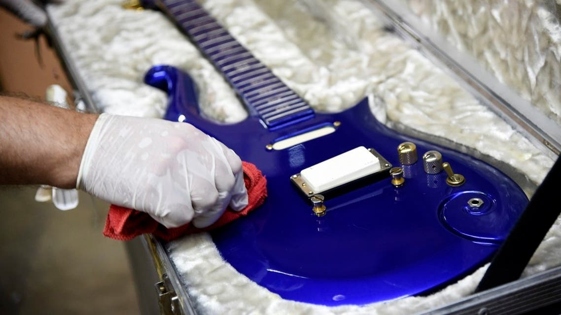 """A blue """"cloud"""" guitar custom-made in the 1980s for the late musician Prince is polished at Julien's Auctions warehouse, Wednesday, May 6, 2020, in Culver City, California. (AP)"""