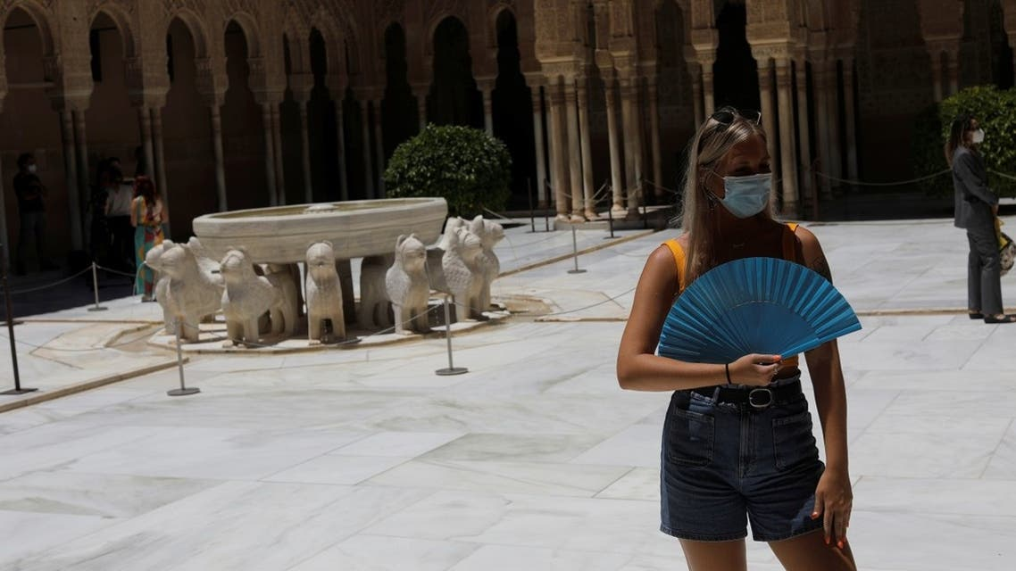 A British tourist stands next to the Lion Fountain in the Court of Lions at Alhambra Palace as it reopens, in Granada, Spain June 17, 2020. (Reuters)