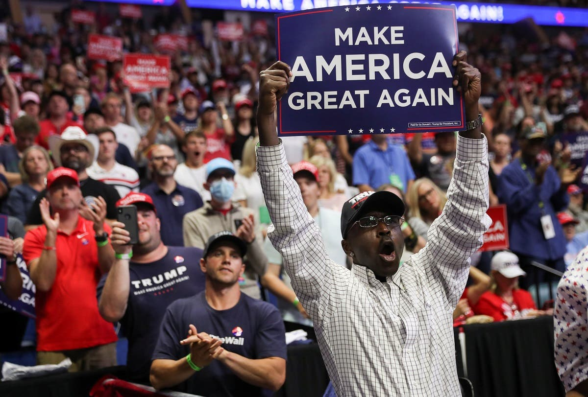 A Black supporter of U.S. President Donald Trump holds up a Make America Great Again sign as the president arrives at his first re-election campaign rally in several months in the midst of the coronavirus disease (COVID-19) outbreak, at the BOK Center in Tulsa, Oklahoma, U.S., June 20, 2020. (Reuters)