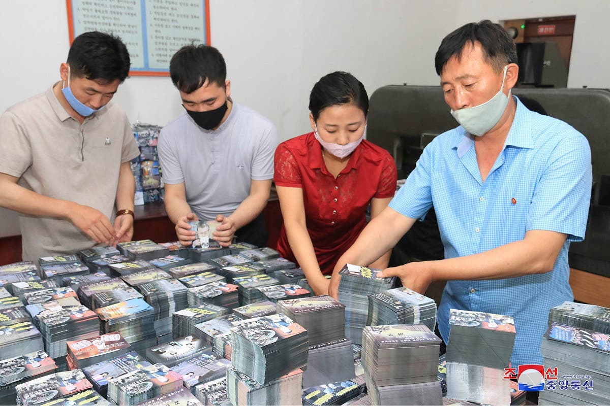 This undated picture released by North Korea's official Korean Central News Agency (KCNA) on June 20, 2020 shows North Koreans preparing anti-Seoul leaflets at an undisclosed location in North Korea. (AFP)