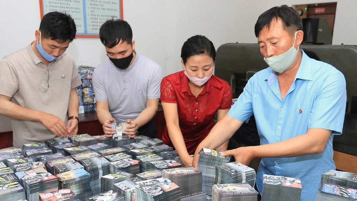 This undated picture released by N.Korea's official Korean Central News Agency on June 20, 2020 shows N.Koreans preparing anti-Seoul leaflets at an undisclosed location in North Korea. (AFP)