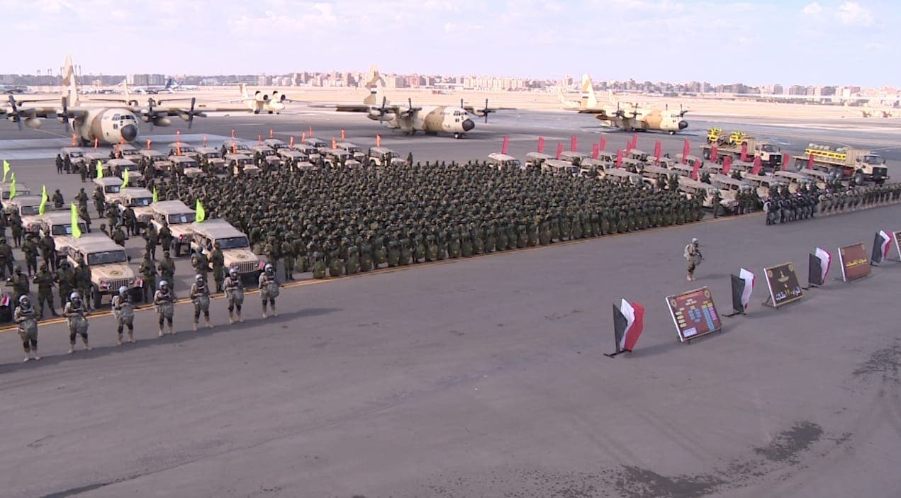 Members of the Egyptian Armed Forces stand next to military vehicles and planes. (Facebook/EgyArmySpox)