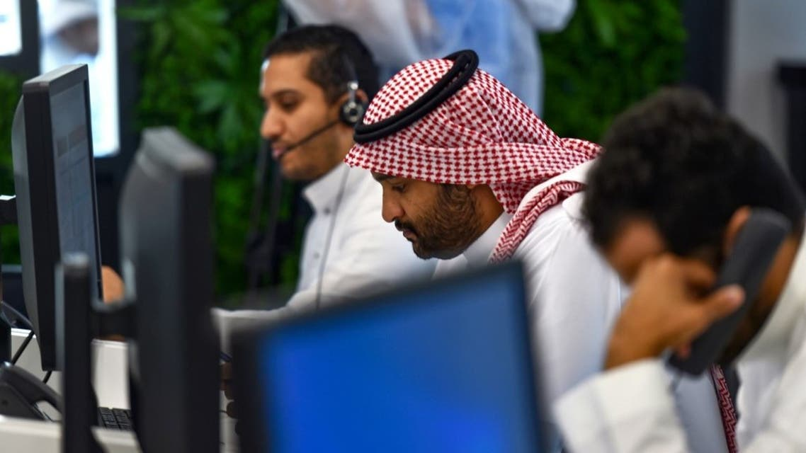 Employees work at the Saudi National Health Emergency Operations Center in the capital Riyadh on May 3, 2020. (AFP)