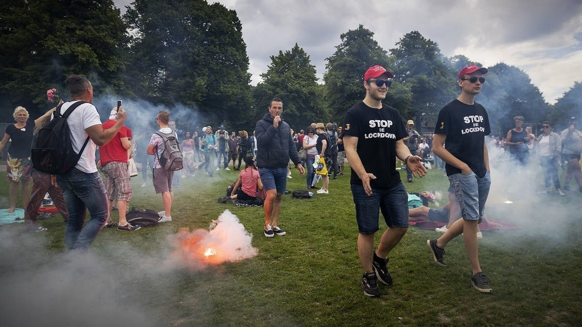 Protesters burn flares as they gather at the city's central Malieveld grounds to demonstrate in The Hague on June 21, 2020. (AFP)
