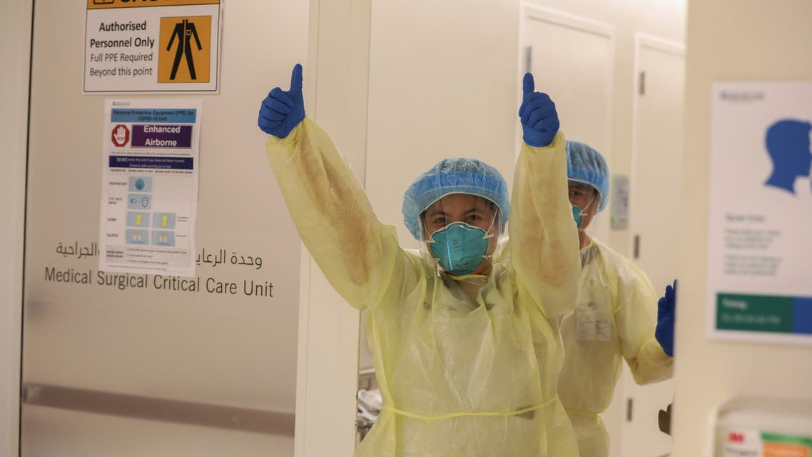 A member of medical staff wearing protective equipment gestures while entering the intensive care unit amid the coronavirus outbreak, at the Cleveland Clinic hospital in Abu Dhabi, United Arab Emirates, April 20, 2020. (Reuters)