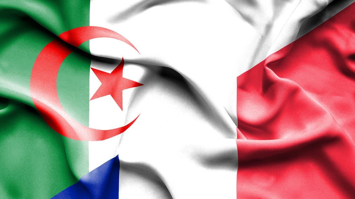 Waving flag of France and Algeria stock photo