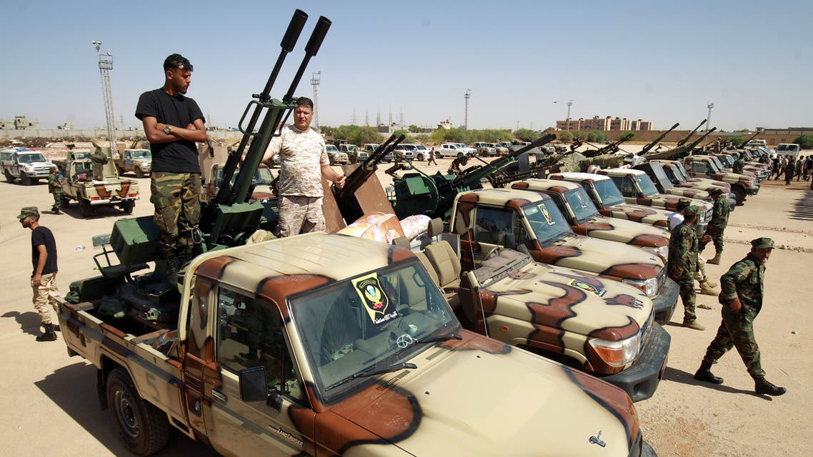 Members of the self-proclaimed eastern Libyan National Army (LNA) special forces gather in the city of Benghazi, on their way to reportedly back up fellow LNA fighters on the frontline west of the city of Sirte, facing forces loyal to the UN-recognised Government of National Accord (GNA), on June 18, 2020. The resurgent GNA has vowed to push on for Sirte, late Libyan leader Moamer Kadhafi's hometown and the last major settlement before the traditional boundary between western Libya and strongman Khalifa Haftar's stronghold in the east.