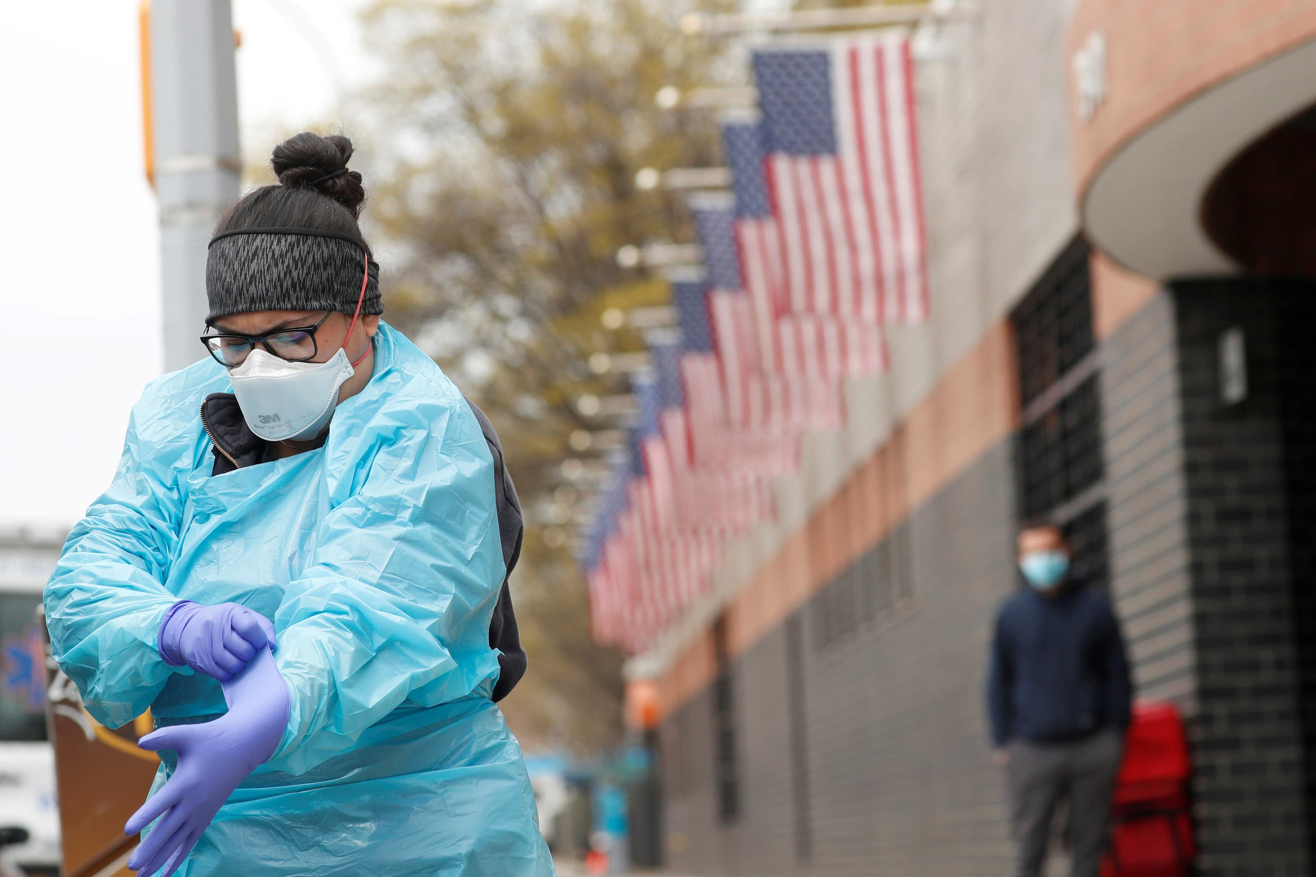 An Emergency Medical Technician (EMT) dons personal protective equipment before going into Elmhurst Hospital during the ongoing outbreak of the coronavirus in the Queens borough of New York, US. (File photo: Reuters)