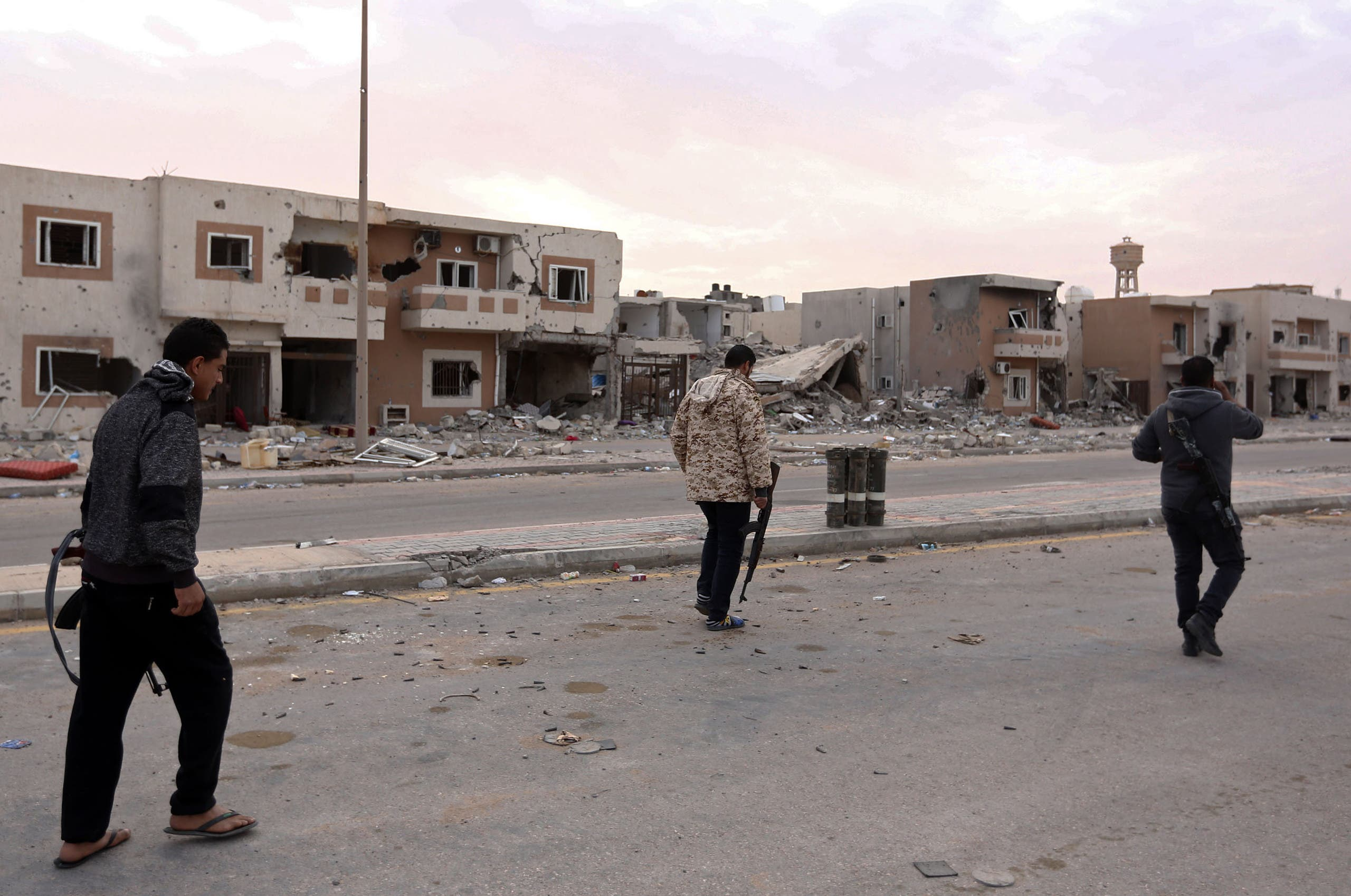 Fighters from the Libyan forces of the National Accord (GNA) patrol Sirte's Al-Giza Al-Bahriya district on December 20, 2016 after they drove the ISIS group out of its Libyan stronghold. (File photo)