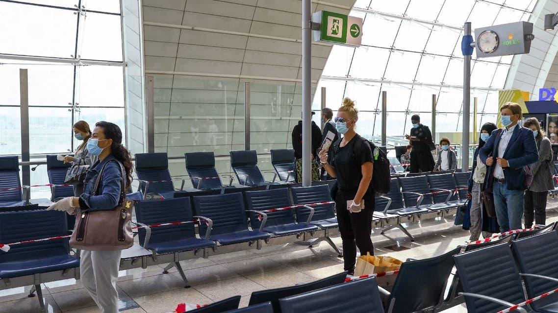 Passengers keep distance in a line at Dubai International Airport amid the outbreak of the coronavirus in Dubai, UAE, April 27, 2020. (Reuters)