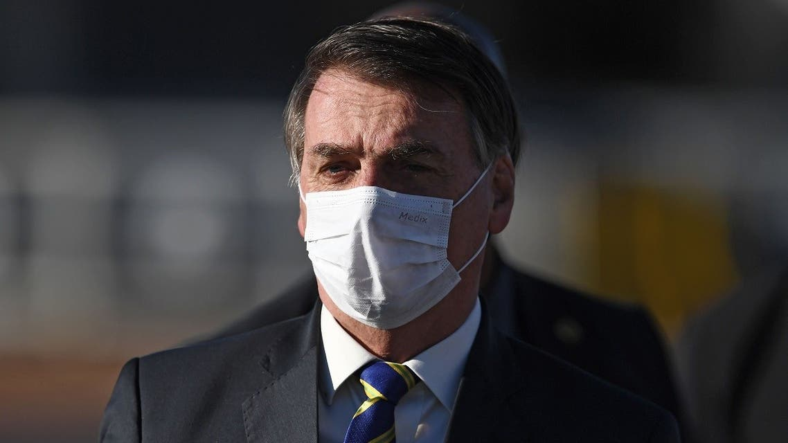 In this file photo taken on May 12, 2020 Brazilian President Jair Bolsonaro wears a face mask as he arrives at the flag-raising ceremony before a ministerial meeting at the Alvorada Palace in Brasilia. (AFP)