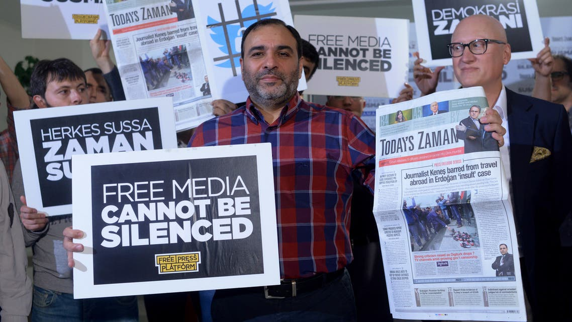 Bulent Kenes, then-editor-in-chief of Today's Zaman, shows his newspaper minutes before police detain him in his office in Istanbul on Oct. 9, 2015. (AP)