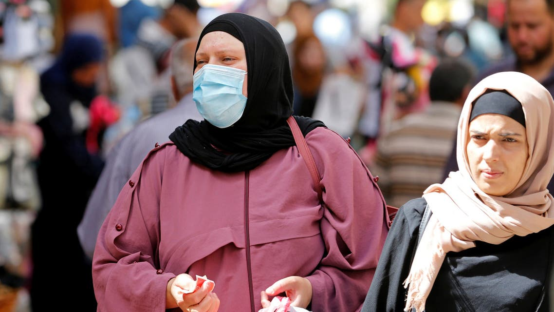 A Palestinian woman wearing a mask shops at a market ahead of the upcoming holiday of Eid al-Fitr marking the end of Ramadan, amid concerns about the spread of the coronavirus disease (COVID-19) in Bethlehem in the Israeli-occupied West Bank May 19, 2020. Picture taken May 19, 2020. (Reuters)