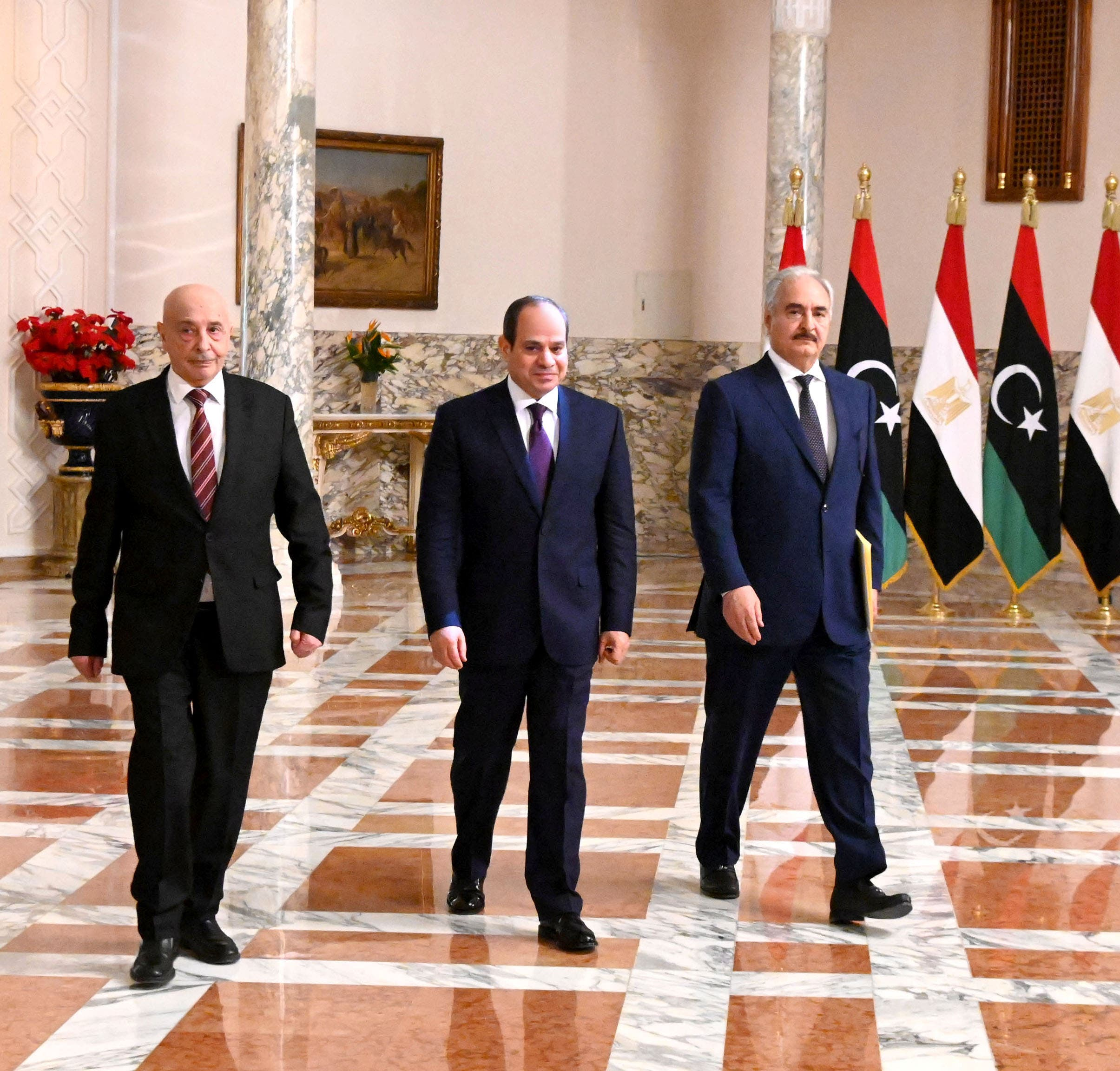 Egyptian President Abdel Fattah al-Sisi (C), Libyan commander Khalifa Haftar (R) and the Libyan Parliament speaker Aguila Saleh arriving for a joint press conference in Cairo. (Egyptian Presidency/Handout)