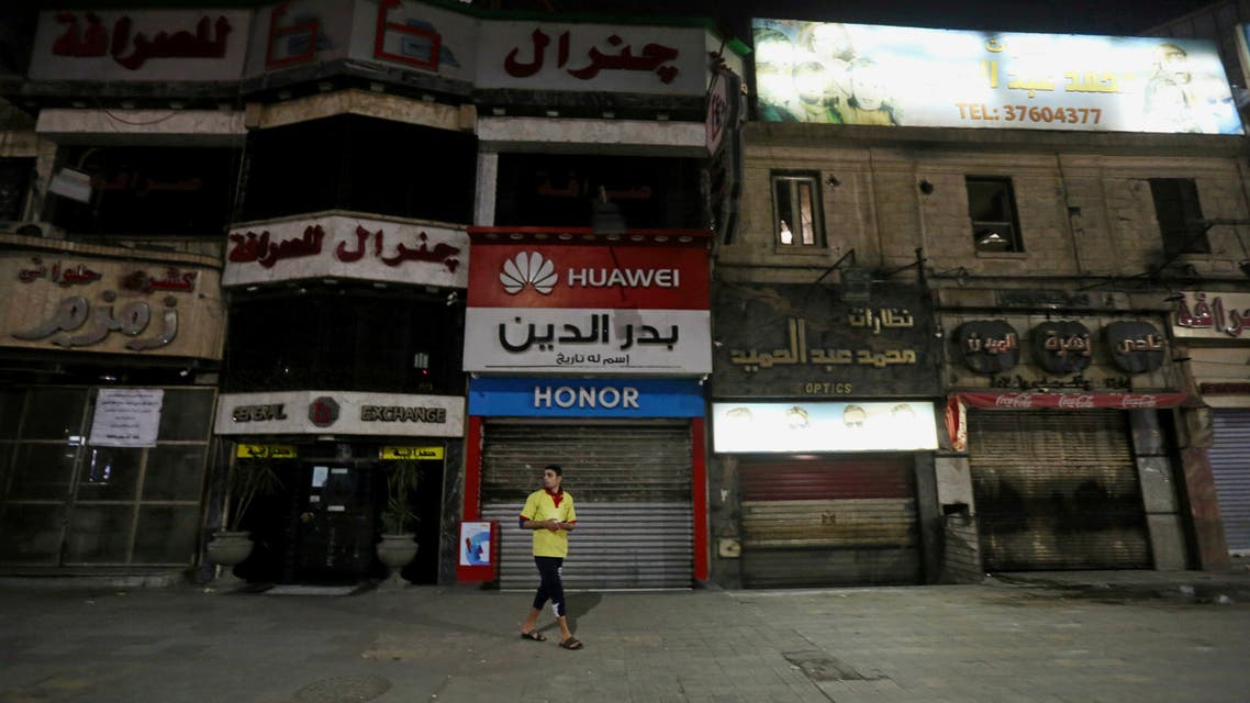 A man walks in front of closed shops, after Egyptian Prime Minister Mostafa Madbouly ordered all restaurants, cafes, cafeterias, night clubs, shopping malls and shops to shut their doors from 0700 p.m. in Cairo. (Reuters)