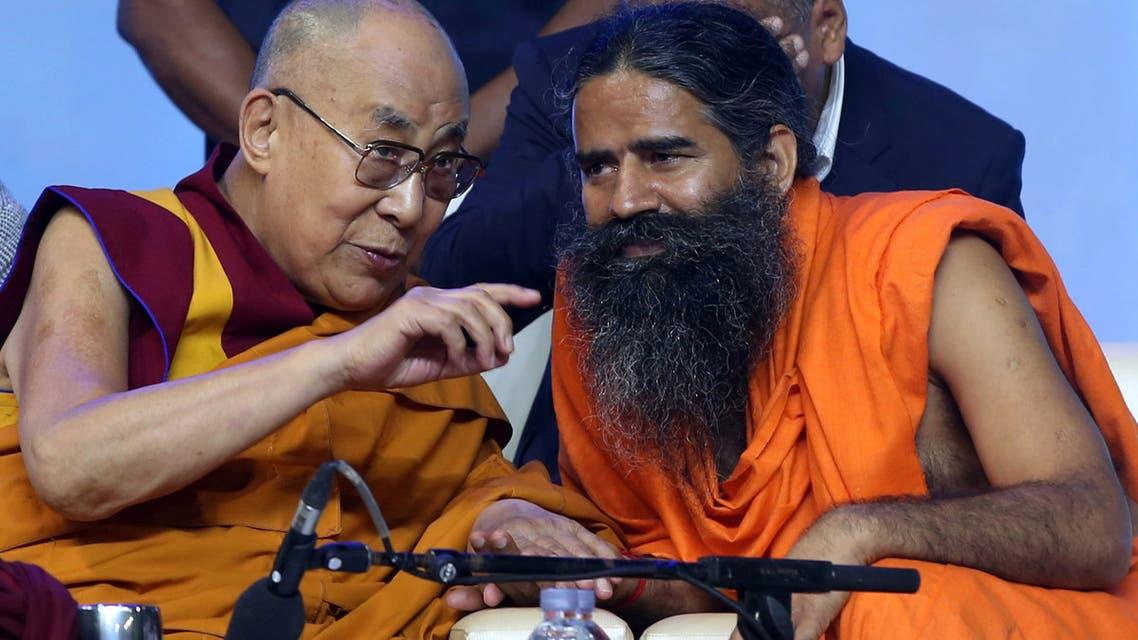 Tibetan spiritual leader the Dalai Lama, left, and Yoga Guru Baba Ramdev in Mumbai, India August 13, 2017. (Reuters)