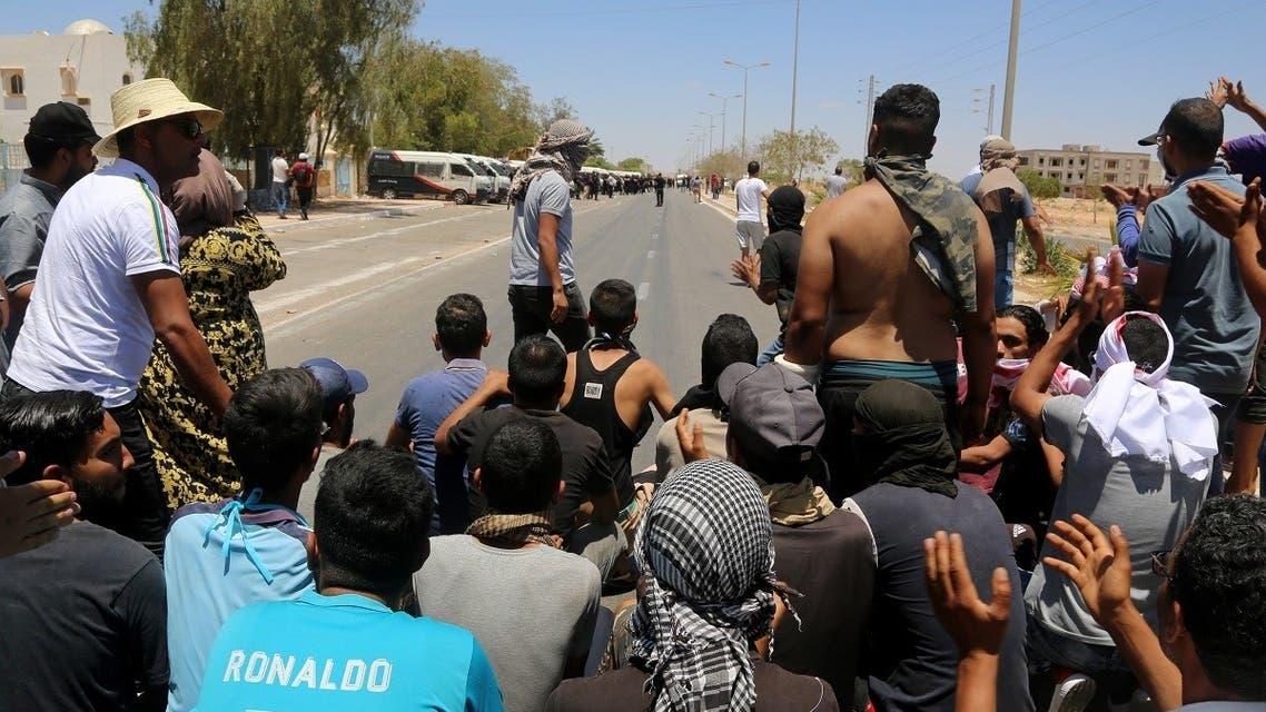 AFP_Tunisians block a road