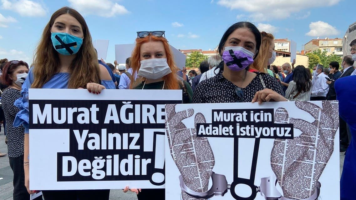 People hold placards that read  Murat Agirel is not alone  and  we want justice for Murat  outside the courthouse, in Istanbul, Wednesday, June 24, 2020. (AP)