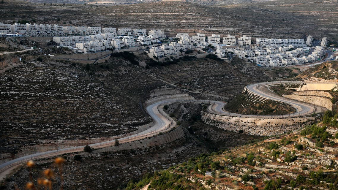 A serpentine road extends between the Jewish settlement of Givat Zeev (background) and Palestinian villages near the Israeli-occupied West Bank city of Ramallah. (File photo: AFP)