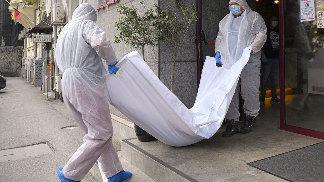 Forensic workers carry the body of Gholamreza Mansouri from a hotel downtown Bucharest, Romania. (AP)
