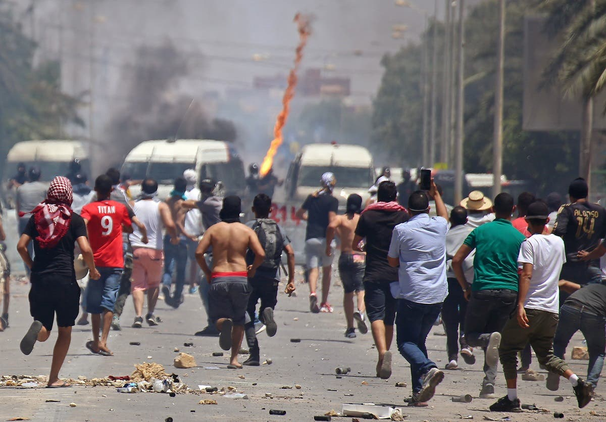 Tunisian protesters clash with security forces as they demonstrate in the southern city of Tataouine on June 22, 2020. (AFP)
