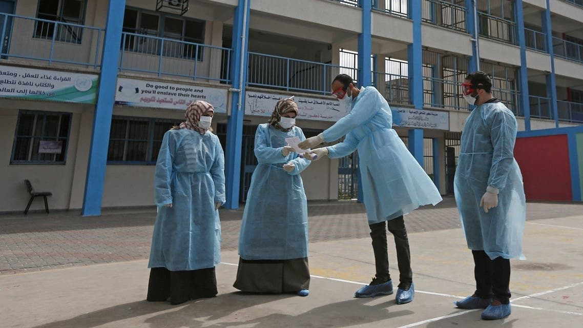 Palestinian health workers in the courtyard of a UNRWA refugees school at al-Shati refugee camp in Gaza City on March 18, 2020. (AFP)
