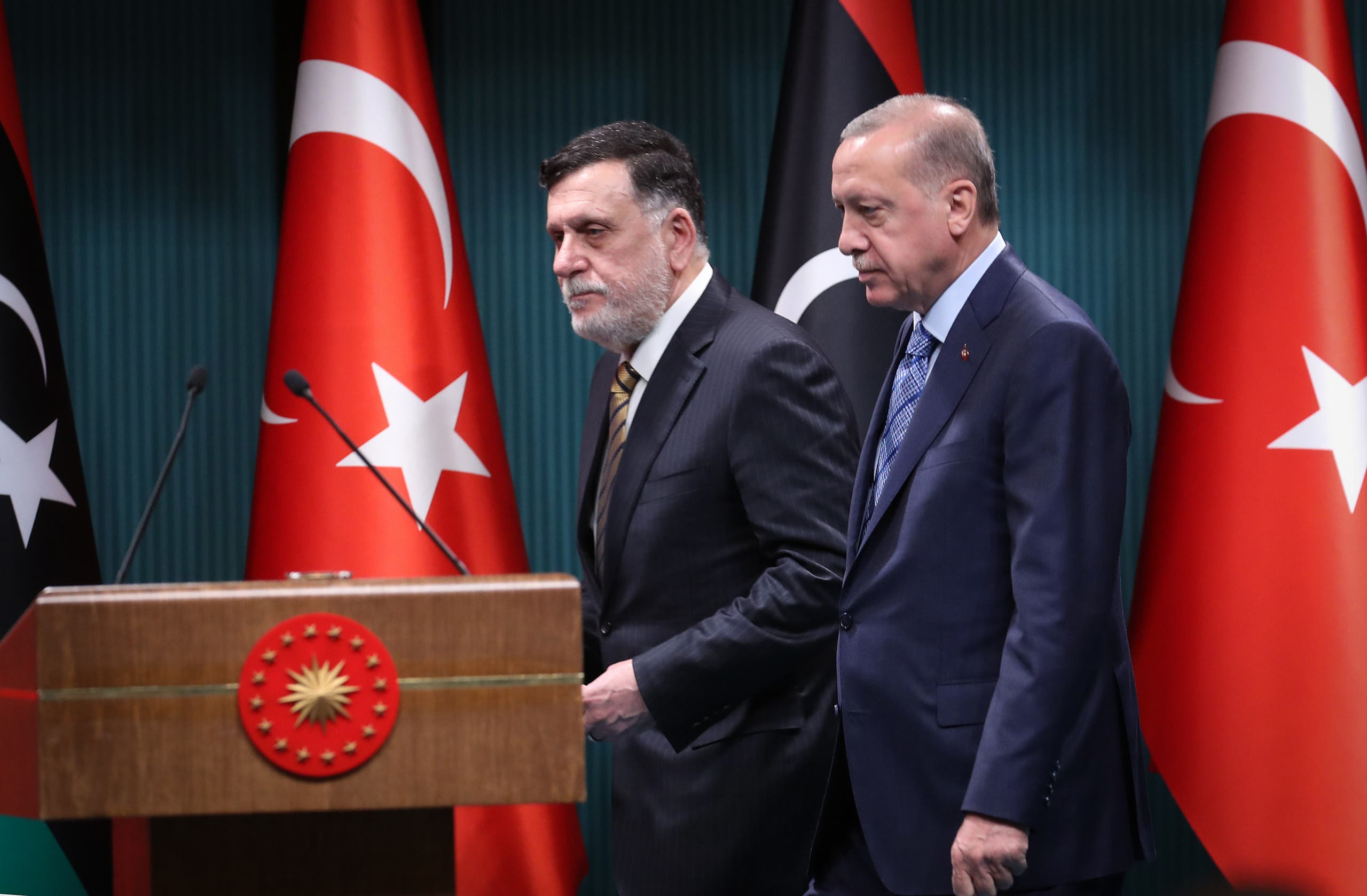 Turkish President Recep Tayyip Erdogan (R) and GNA leader Fayez al-Sarraj (L) arrive for a joint press conference in Ankara on June 4, 2020. (AFP)