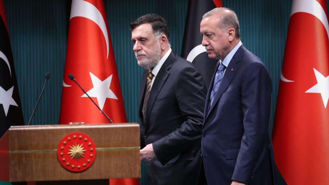 Turkish President Recep Tayyip Erdogan (R) and Libyan GNA leader Fayez al-Sarraj (L) arrive for a joint press conference in Ankara on June 4, 2020. (AFP)