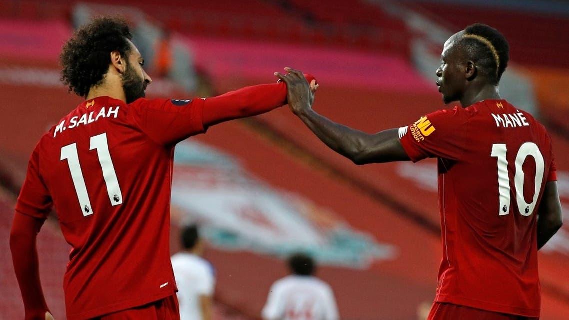 Mohamed Salah (L) and Sadio Mane (R) celebrate during a match, June 24, 2020. (AFP)
