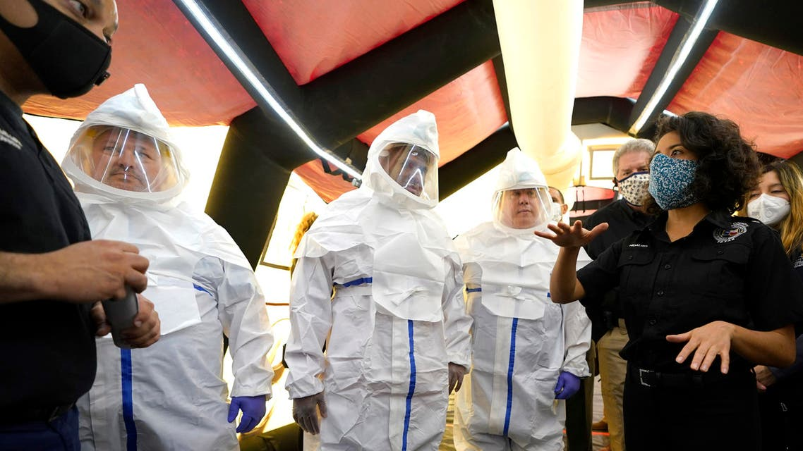 Texas officials inside the intensive care unit during a tour of the new Harris County Non-Congregate Medical Shelter at NRG Park Saturday, April 11, 2020, in Houston. (AP)