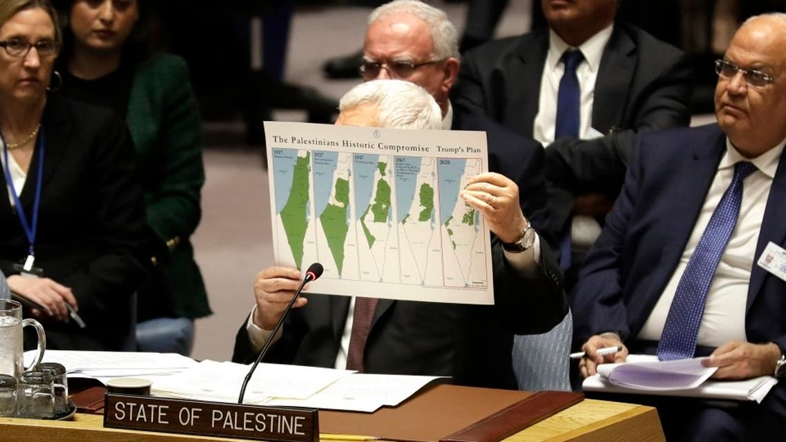 Palestinian President Mahmoud Abbas holds up a document as he speaks during a Security Council meeting at UN headquarters. (File photo: AP)