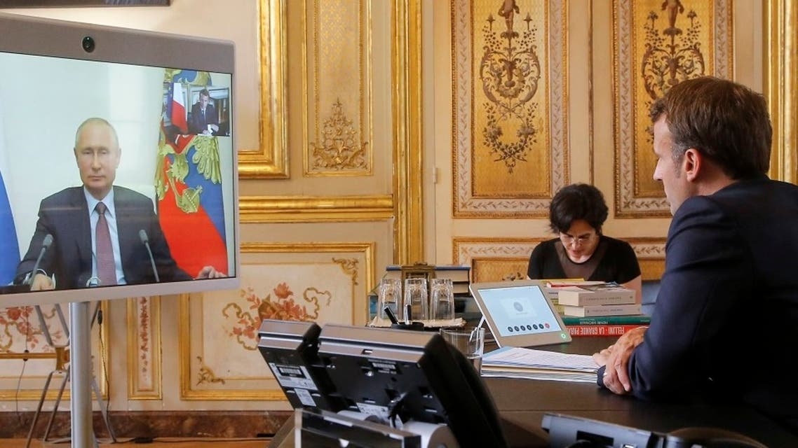 French President Emmanuel Macron talks to Russian President Vladimir Putin during a video conference on June 26, 2020. (AFP)