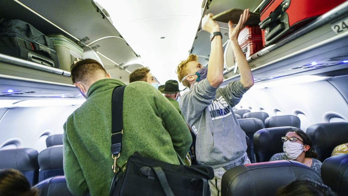 Passengers board an American Airlines flight to Charlotte, North Carolina at San Diego International Airport on May 20, 2020 in San Diego, California. (File Photo: AFP)