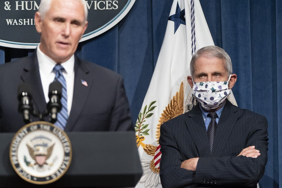 Dr. Anthony Fauci watches as Vice President Mike Pence speaks after a White House Coronavirus Task Force briefing, June 26, 2020. (AFP)